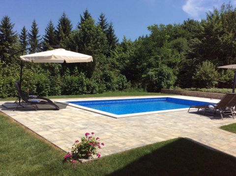 Garden and pool in lush countryside