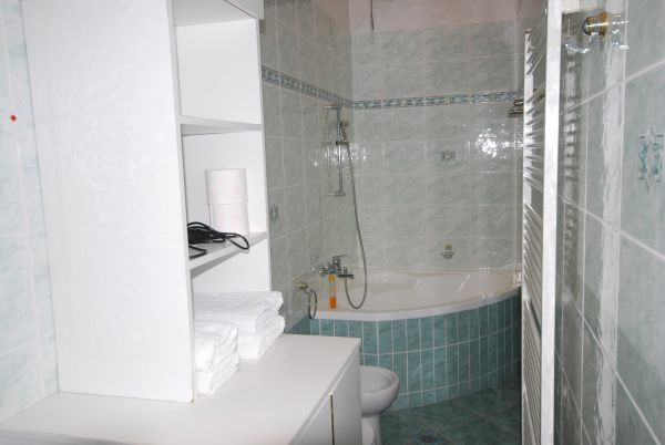 Bathroom with corner bath and shower