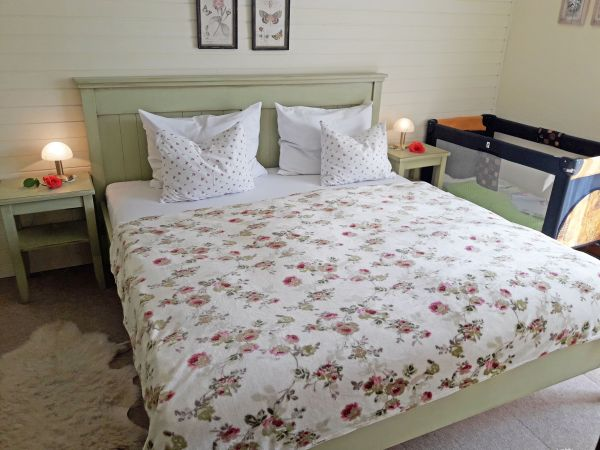 Double bedroom one with baby cot